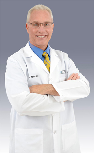 John M. Brooks, MD